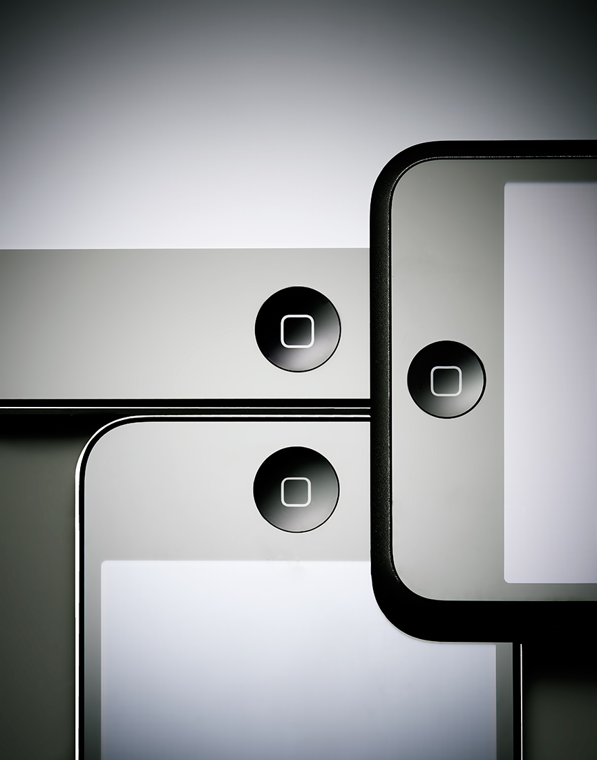 Three black iPods on dark background by Ted Cavanaugh