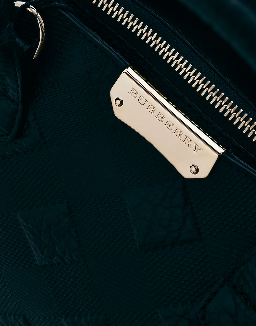 Burberry Purse on black by Ted Cavanaugh