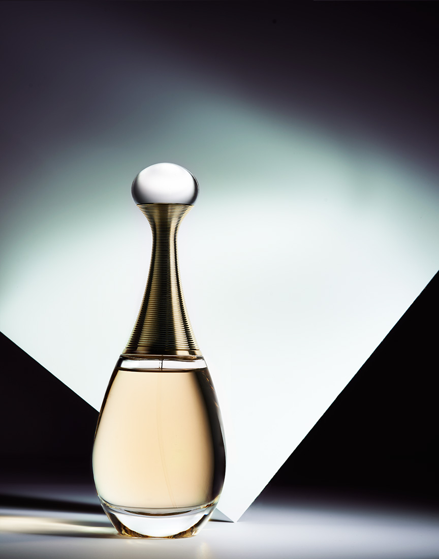 Dior Fragrance on contrasty surface  by Ted Cavanaugh