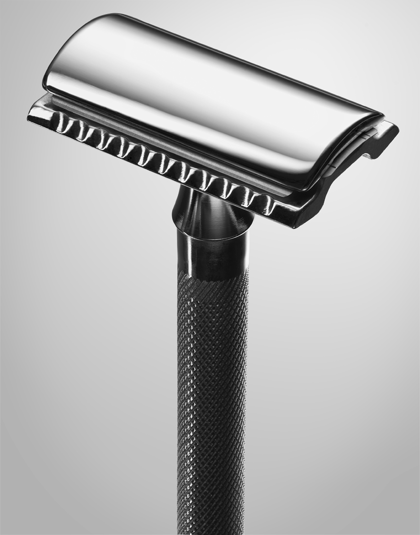 Double Edged safety razor on grey background by Ted Cavanaugh