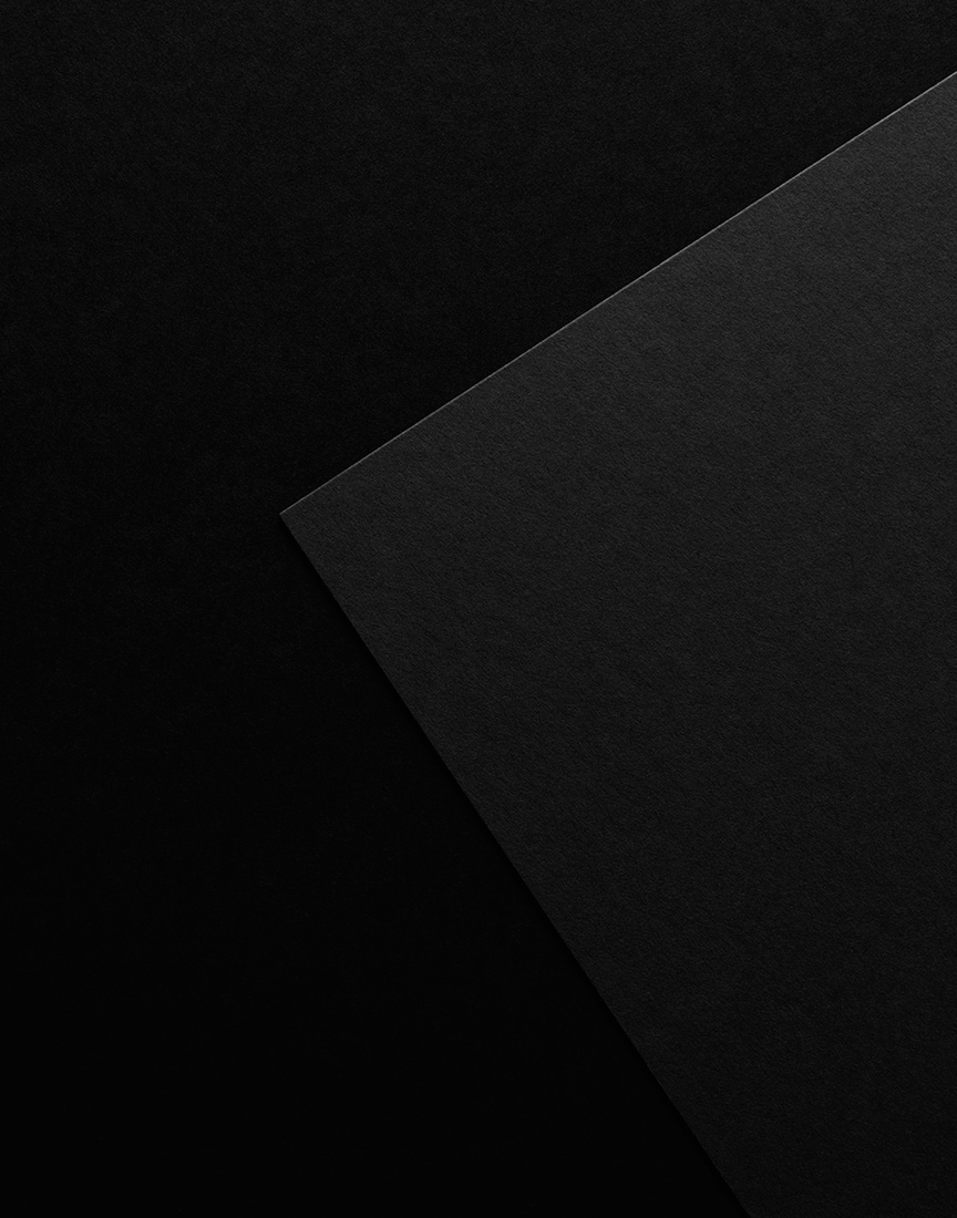 A compositional shot of white and black paper  by  Ted Cavanaugh