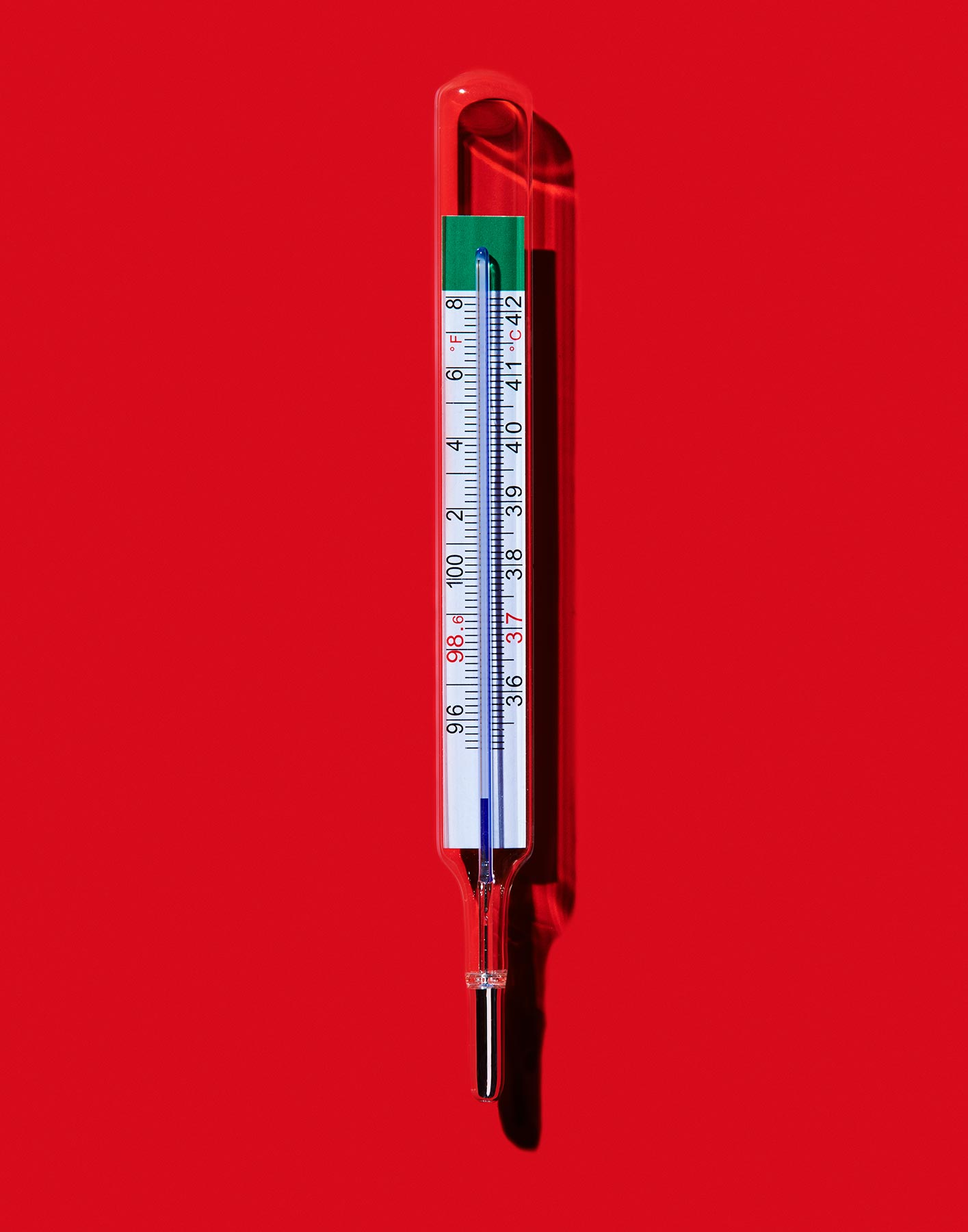 thermometer on bright red surface  by Ted Cavanaugh